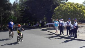ladies cheering on the bicyclists